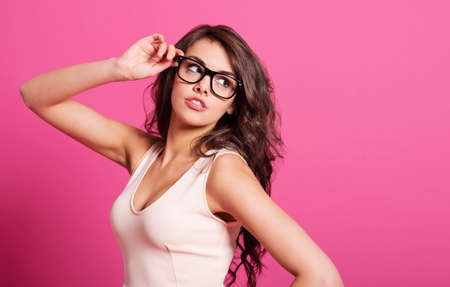 Sexy woman posing with fashion glasses   photo