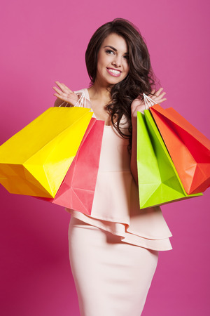 Satisfied smiling woman after spring shopping  photo