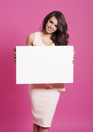 woman sex: Smiling woman with empty whiteboard  Stock Photo