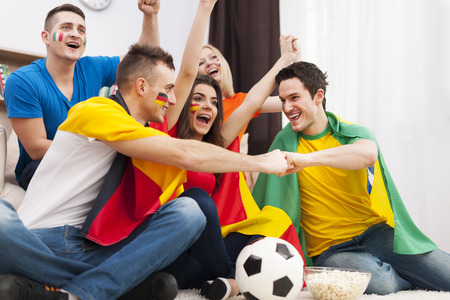 Friends of different nations supporting football team   photo