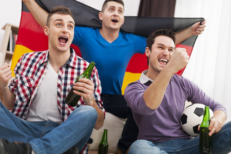 Germany men cheering football match  photo