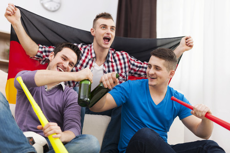 Germany men celebrating win of favorite football team photo