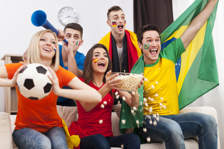 group goals: Friends of different nations celebrating goal of favourite team
