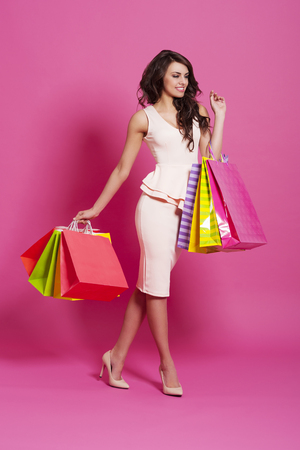 Beautiful woman with multi colored shopping bags  photo
