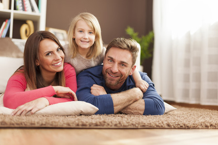 Portrait of loving family on carpet  photo