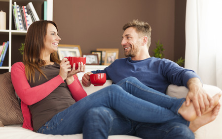 Lovely couple relaxing at home photo