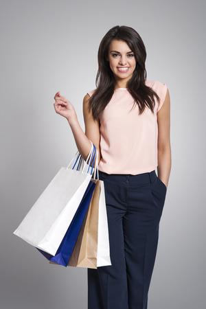 Beautiful elegant woman holding shopping bags  photo