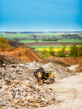 quarries: Earth mover in industry area