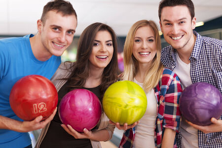 Portrait of group of people at the bowling alley photo
