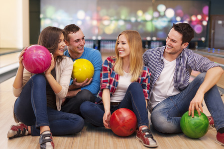bowling alley: Young group of friends have fun at bowling alley