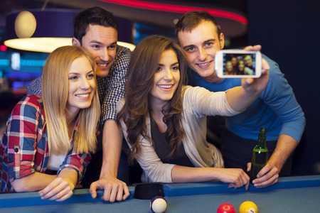 Group of friends catching memories from billiard club photo