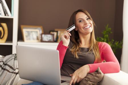 house shopping: Beautiful woman loving online shopping   Stock Photo