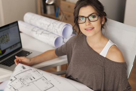 architect office: Young architect working in home office  Stock Photo