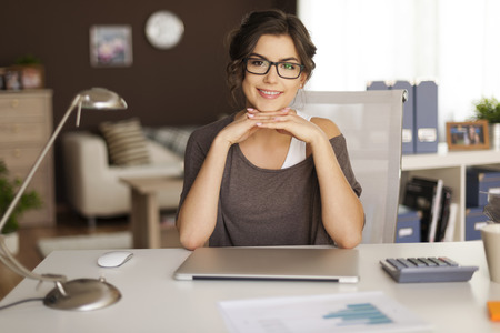 Portrait of beautiful woman in home office  photo