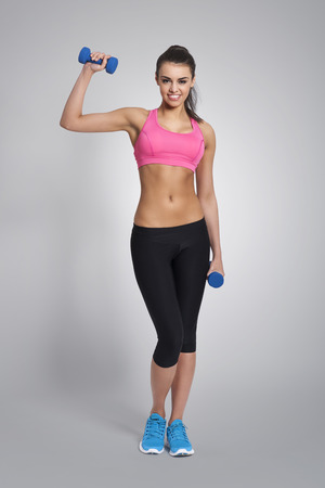 hand bra: Gorgeous fitness instruktor with dumbbells Stock Photo