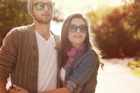 Portrait of happy embracing couple in sunlight   photo