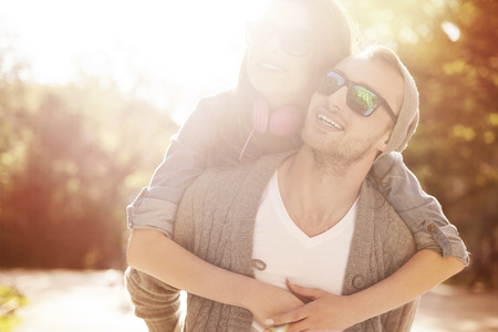 couple lit: Portrait of loving couple in sunny day  Stock Photo