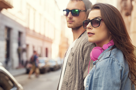 walking street: Fashion hipster couple in the street   Stock Photo