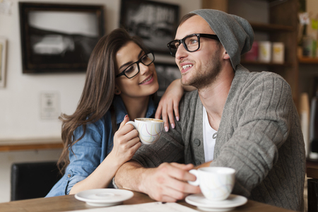 Happy man and woman in cafe