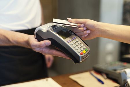 cafes: Close up of customer paying by credit card