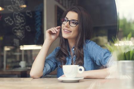 Beautiful woman wearing fashionable glasses at cafe  photo
