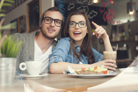 women glasses: Happy couple spending lunch time together in restaurant