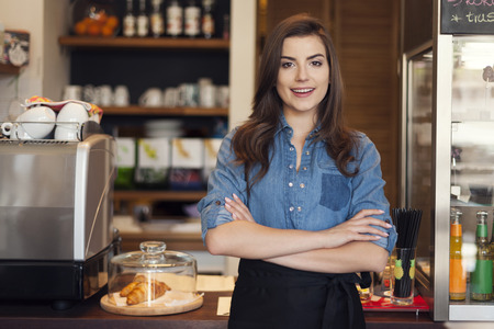 Portrait of friendly waitress at work Stock Photo
