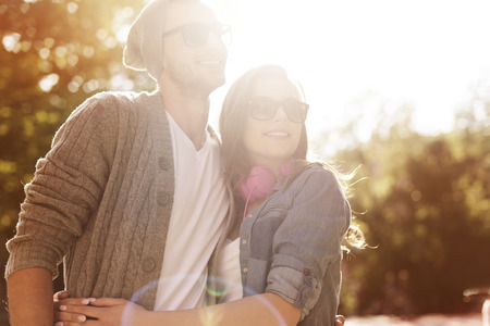 couple lit: Portrait of hipster couple in sunny day  Stock Photo