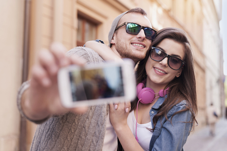 Loving couple taking selfie in the city photo