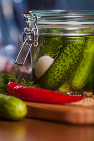 fermenting: Close up of jar with pickled cucumbers  Stock Photo
