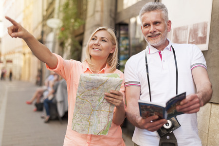 guidebook: Mature tourist sightseeing city with map and guidebook