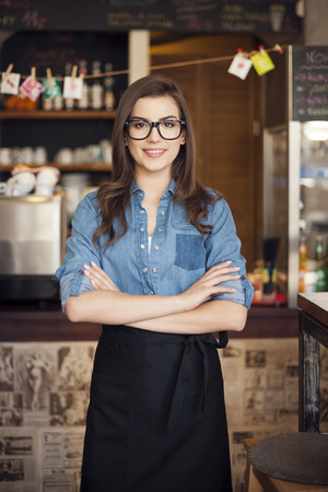 Portrait of nerdy waitress at work   photo