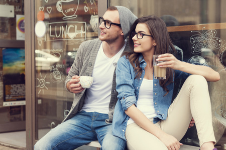 Portrait of stylish couple at outside of cafe  Stock Photo