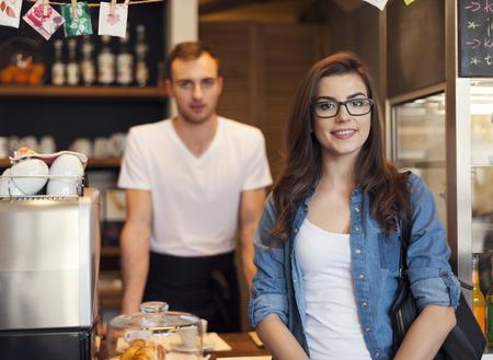 Portrait of smiling waiter and beautiful female customer  Stock Photo