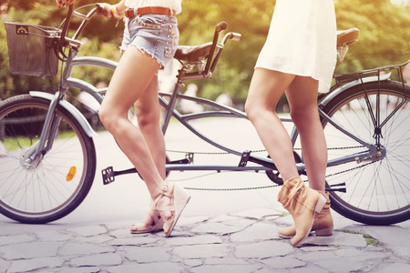 tandem bicycle: Part of boho girls ready to cycling   Stock Photo