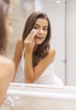 removing make up: Woman removing makeup from her face