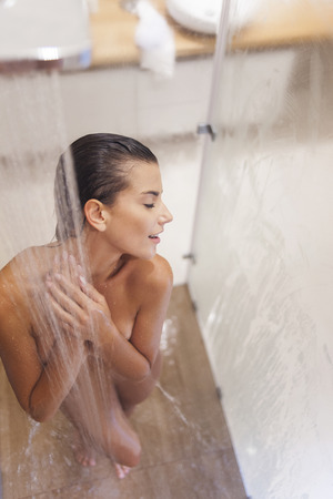 nude wet: Attractive woman enjoying time under shower  Stock Photo