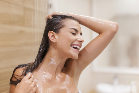 Woman has fun under the shower  photo