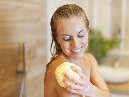 body care: Beautiful blonde woman taking shower  Stock Photo