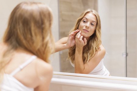 clean skin: Blonde woman has problems with skin on the face