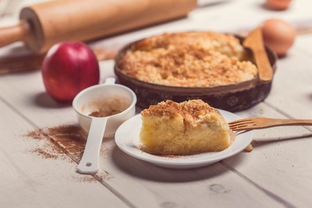 Close up of pie apple with cinnamon on wooden desk photo