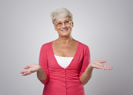 Lovely senior woman with open hands  photo