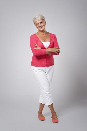 cross process: Beautiful happy senior woman wearing fashion clothes