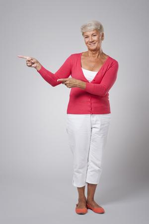 Beautiful fashion woman showing at copy space  photo