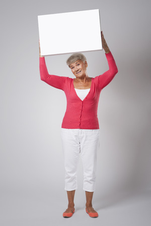 Smiling woman with empty whiteboard  photo