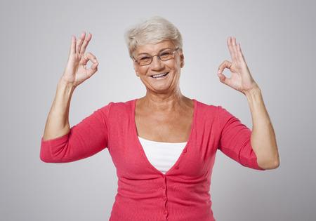Senior woman gesturing ok sign  photo