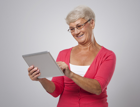 abreast: Senior woman is keeping abreast with new technology