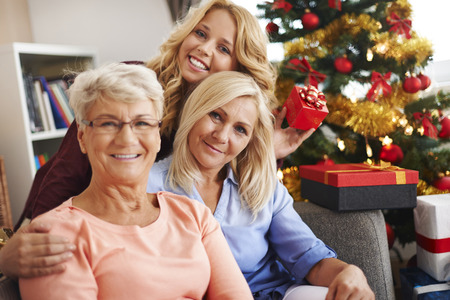 grandmother mother daughter: We keeping our family traditions alive during the Christmas  Stock Photo