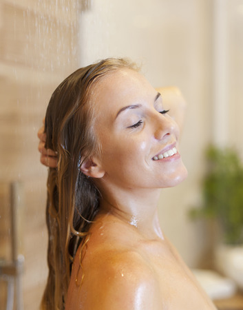 Close up of relaxed woman under the shower  photo