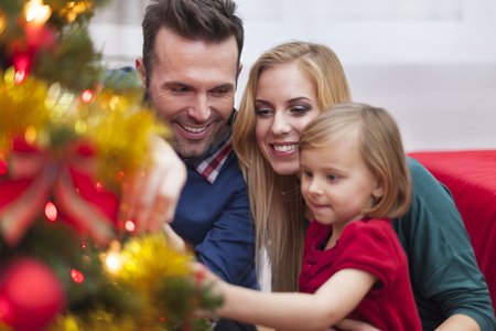 decorating christmas tree: Decorating tree is my favourite Christmas traditions